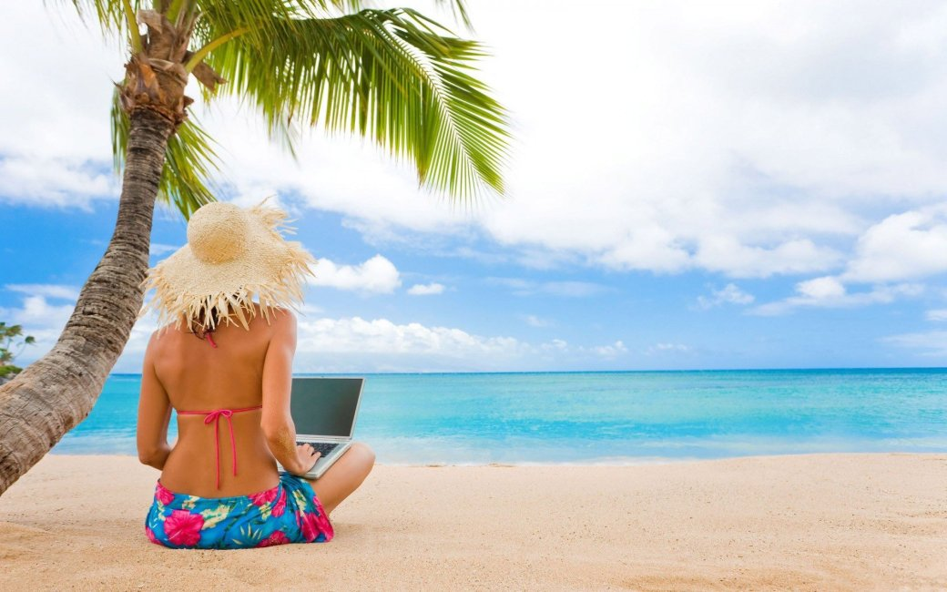 sand-sea-palm-woman-laptop